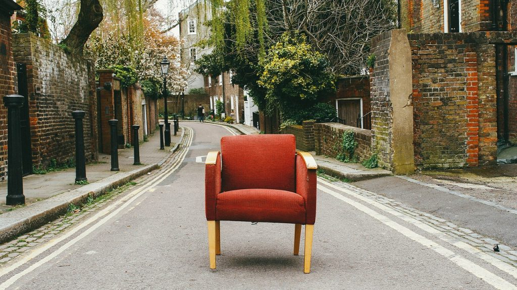 empty chair on an empty street - a metaphor for deserted streets during the covid-19 crisis